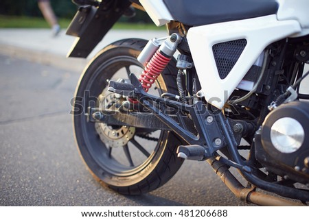Close up view of motorcycle back wheel (wheelie)
