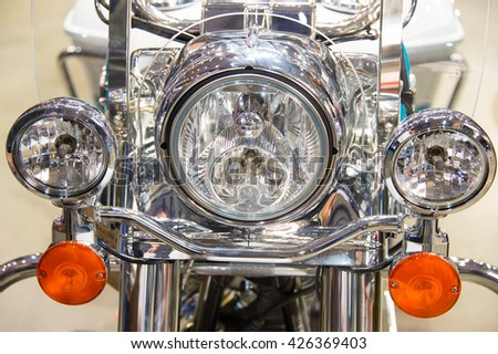 Close-up view of motorcycle headlight