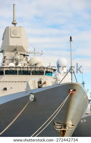 Close-up view of naval ship with gun. - stock photo