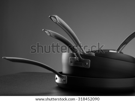 close up view of nice cookware set on grey back - stock photo
