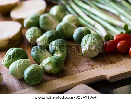 close up view of nice fresh vegetables on color background