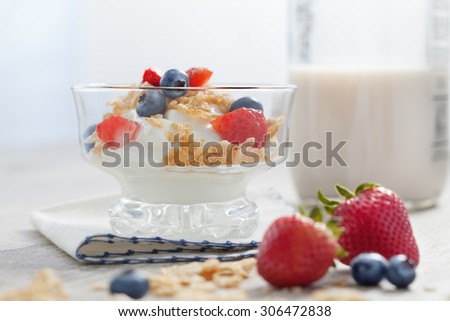 close up view of nice fresh yummy parfait on color back  - stock photo