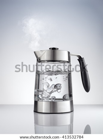 close up view of nice metal tea kettle on grey color background - stock photo
