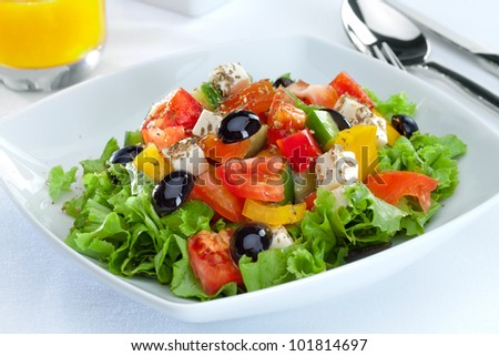 close up view of nice  vegetable salad  on white back