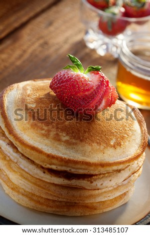 close up view of nice yummy pancakes on color back