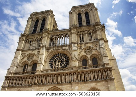 Close up view of Notre Dame Cathedral in Paris. Towering, 13th-century cathedral with flying buttresses & gargoyles, setting for Hugo's novel.