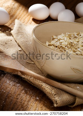 close up view of oat flakes with eggs on color back - stock photo