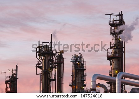 Close up view of oil refinery piping and towers - stock photo
