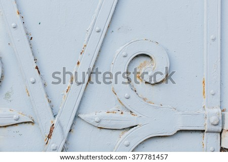 Close up view of old painted white gate with bits of rust showing through for rustic background