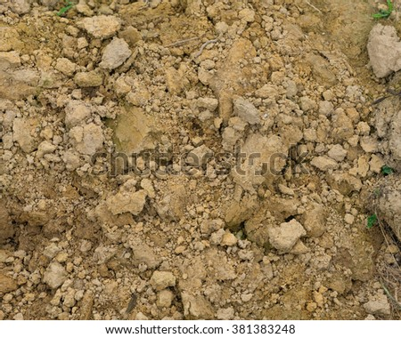 Close-up view of organic friable soil ground at the farmland in the countryside of Viet Nam. Seamless texture of cultivated gray dried plowed soil of an agricultural field. Rural and Nature background - stock photo