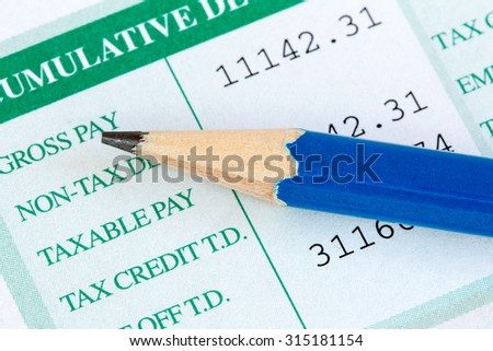 Close up view of pencil and wage slip - stock photo