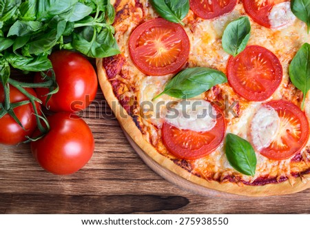 Close up view of pizza Margarita on wooden background - stock photo
