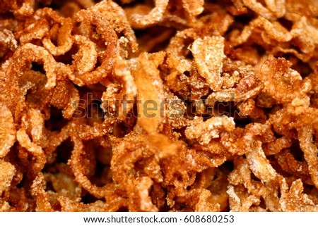 Close-up view of pork snack or also called pork rind, the leather or leather lean pork fried crispy and blistered. Junk Food that's Good for You.
