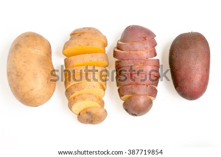 Close up view of potatoes isolated on a white background.
