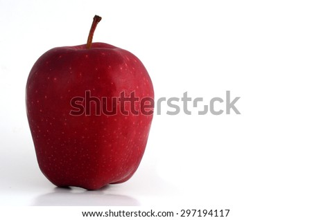 Close up view of red apple isolated on a white background.