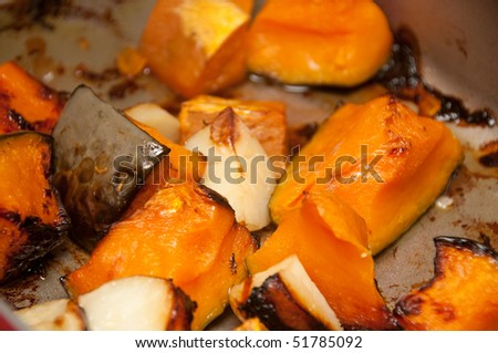 close up view of roast pumpkin and roast potatoes - stock photo