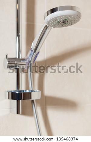 Close up view of shower head on the wall of bathroom