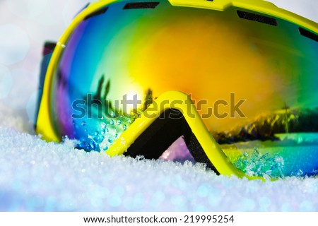 Close up view of ski mask on snow with snowflakes - stock photo
