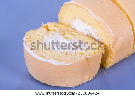 Close up view of sliced banana tasty cake in plate. - stock photo
