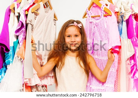 Close-up view of small girl choosing clothes