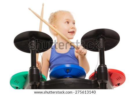 Close-up view of small girl playing on cymbals - stock photo