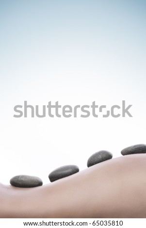 close up view of spa procedure on blue back - stock photo