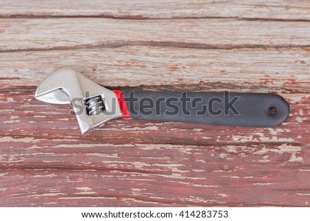 Close up view of spanner on wood board