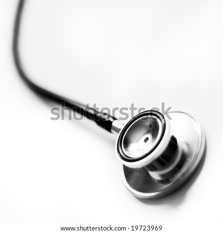 Close up view of stethoscope against white. - stock photo