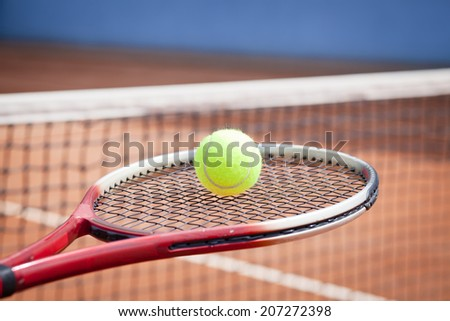 Close up view of tennis racket and tennis ball