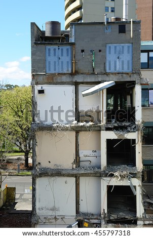 Close-up view of the building during demolition - stock photo