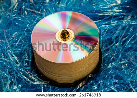 Close up view of the compact disc on a blue background material objects. - stock photo