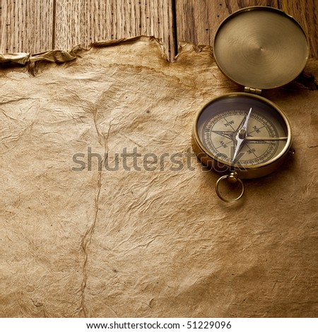 Close up view of the compass on old paper - stock photo