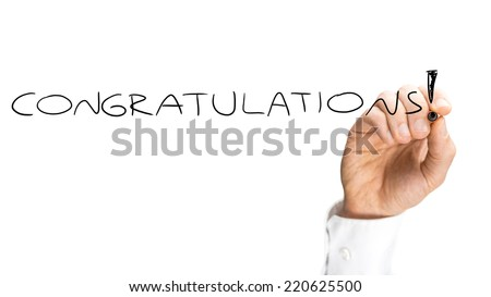 Close up view of the hand of a man writing - Congratulations - on a blank white virtual screen with a marker in praise of an achievement or success with copyspace for your text. - stock photo