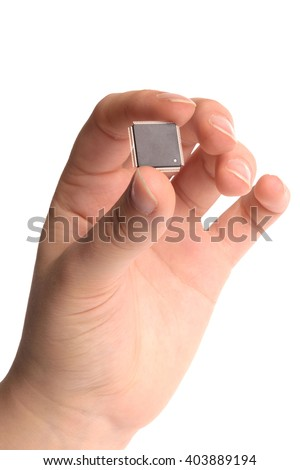 Close-up view of the hand of young girl gesturing with electronic components - transistor and microprocessor, taken on white background - stock photo