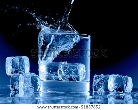 Close up view of the ice cubes splash in water on black - stock photo