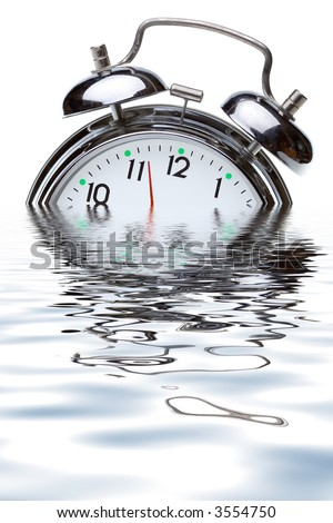 close-up view of the oldfashioned alarm clock in water - stock photo