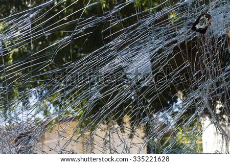 Close-up view of the rear windshield is cracked crash because the accident leaves the scene. - stock photo