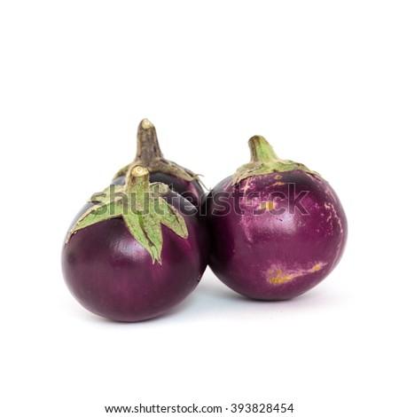 Close-up view of three fresh organic raw ripe Eggplants (or Brinjal, aubergine) isolated on white background. - stock photo