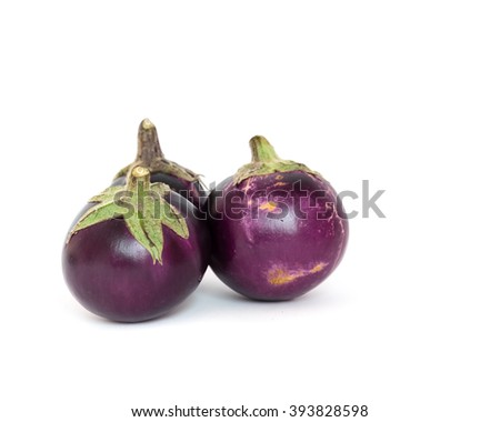 Close-up view of three fresh organic raw ripe Eggplants (or Brinjal, aubergine) isolated on white background. Copy space. - stock photo