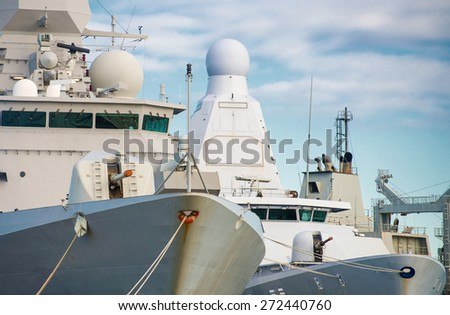 Close-up view of three naval ships. - stock photo