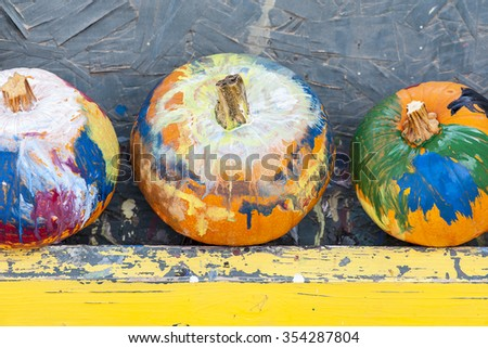 Close-up view of three painted holiday pumpkins, shallow DOF - stock photo