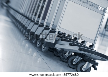 Close up view of trolleys  luggage in a raw in airport