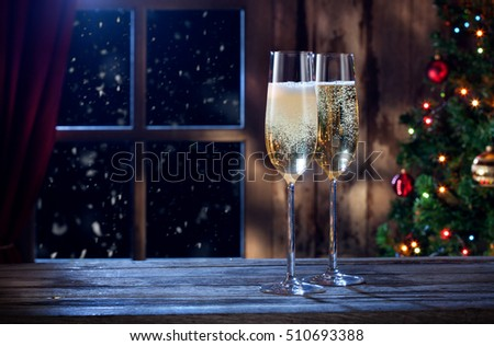close up view of two glasses with champagne  on color back