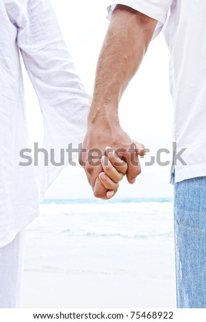 Close up view of two hands holding each other - stock photo