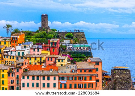 Close up view of Vernazza houses and castle tour. - stock photo