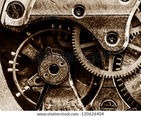 Close up view of vintage clock's gears - stock photo