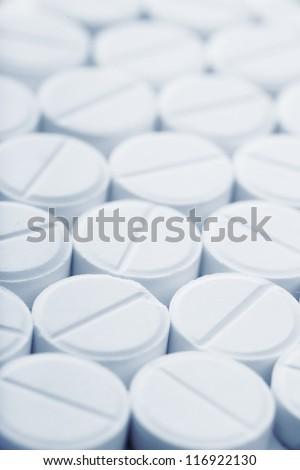 Close up view of white pills - stock photo