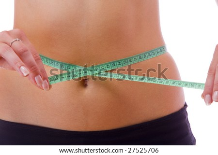 Close up view of woman measuring her waist on white back