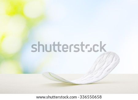 close up view of woman's sanitary pad on color back - stock photo