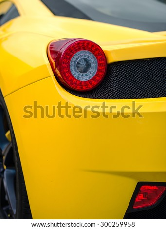 Close-up view of yellow sports car rear light. - stock photo